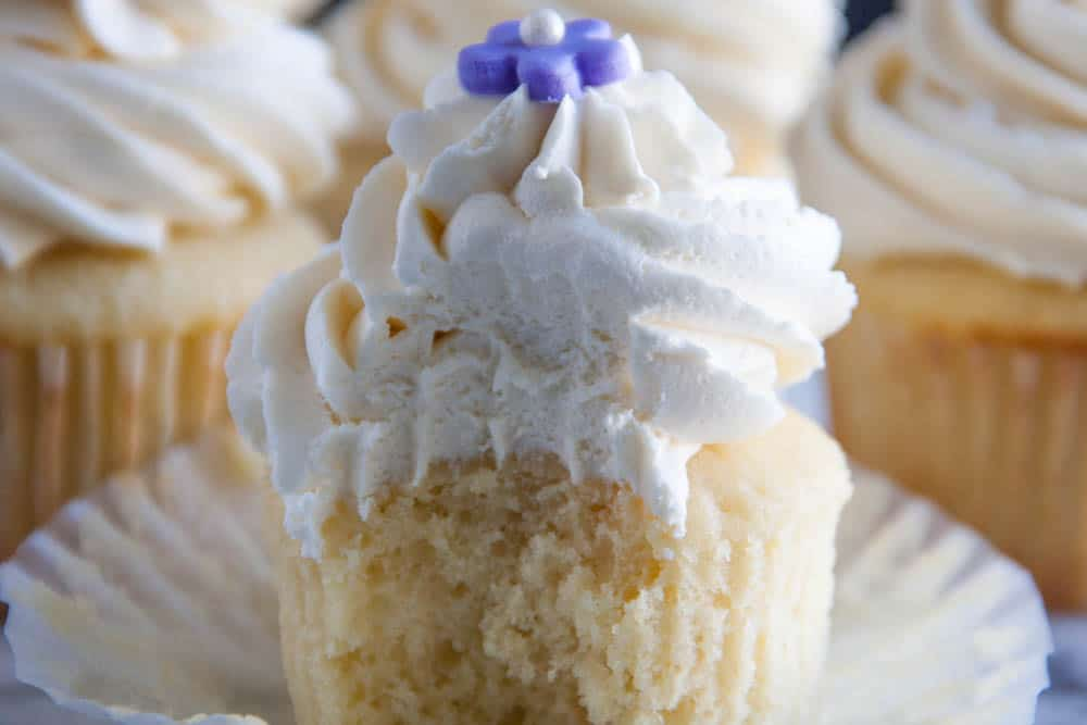 Perfect Vanilla Cupcakes Every time! Fluffy and light and moist- and topped off with the best vanilla buttercream frosting ever. Hands down. Definitely save this pin for later