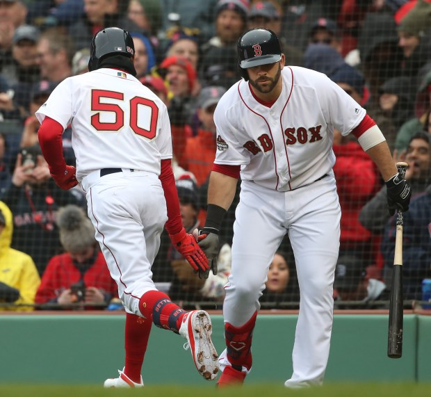 5a757e49d BOSTON MA. – APRIL 9  Boston Red Sox right fielder Mookie Betts is  congratulated at home by Mitch Moreland after his solo home run during the  sixth inning ...