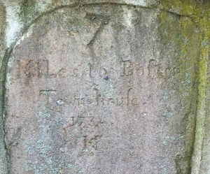 "Milestone with the caption ""7 Miles to Boston Townhouse 1734"""