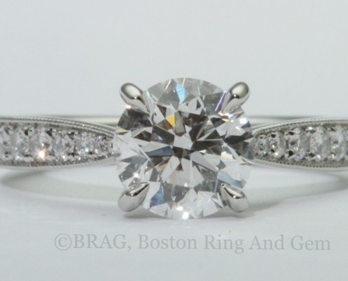 Platinum and diamond Cathedral tapered solitaire with Mill grain edge