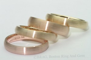 A rainbow of 14k and 18k Yellow and Rose Men's Wedding Rings