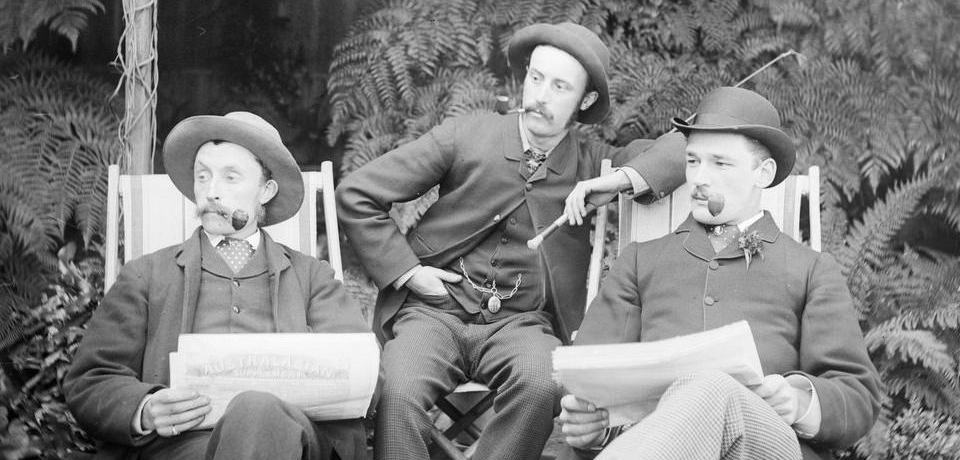 Three men, reading