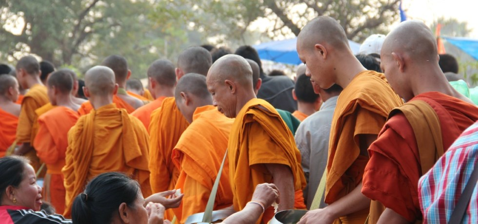 Monks collecting alms