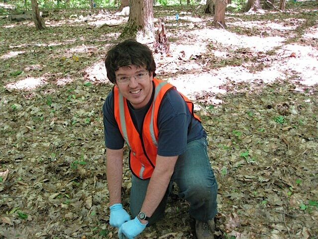 Former University of Michigan postdoctoral research fellow Zac Freedman collects a soil sample at a study site in Oceana County, Michigan