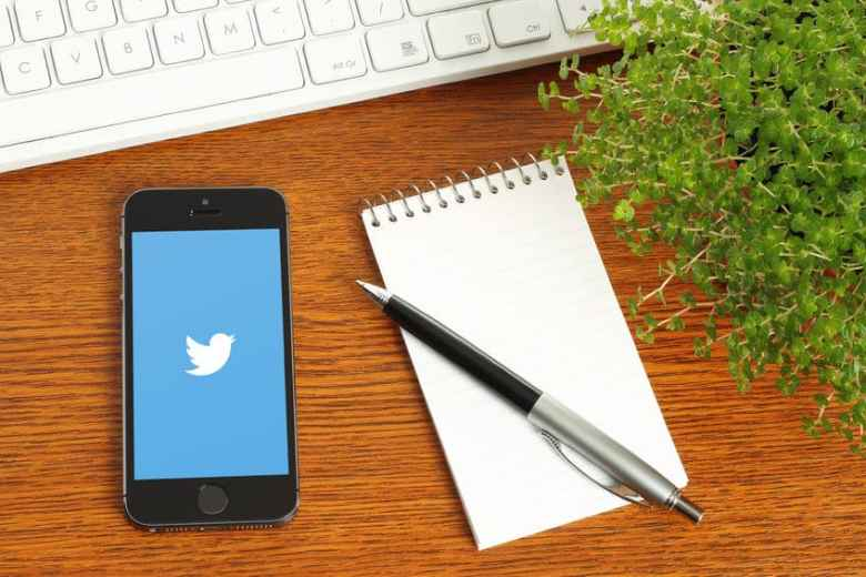 iPhone with Twitter on a desk