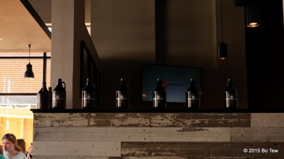 Bottles of Grolwers sitting on the wall.