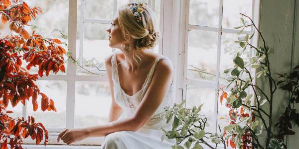 Bride by window. Bridal hair and makeup by Melissa Oldridge. Photo Mindy Coe Photography