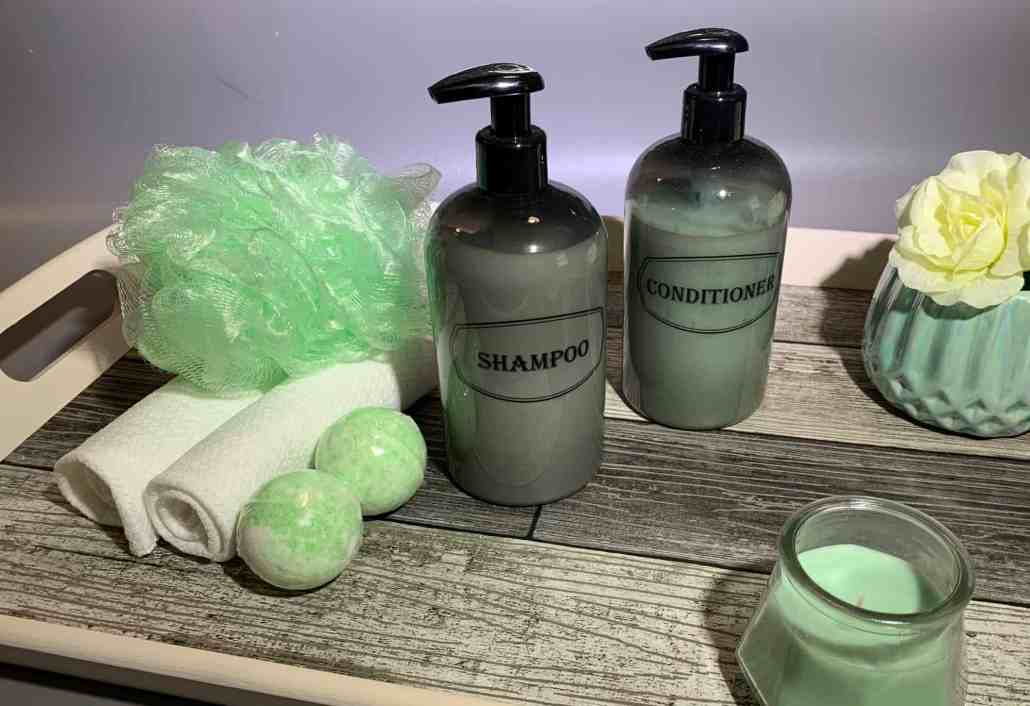 Gray shampoo and conditioner bottle flat lay