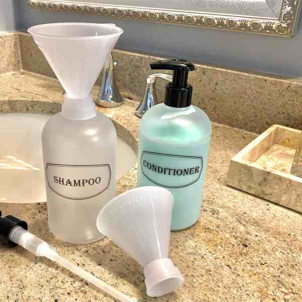 Funnel set in use with frosted clear bottles in bathroom setting
