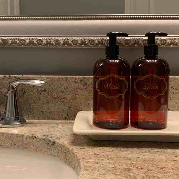 Amber wash and lotion bottles on bathroom counter
