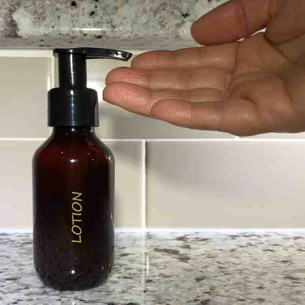 Amber travel lotion bottle w hand