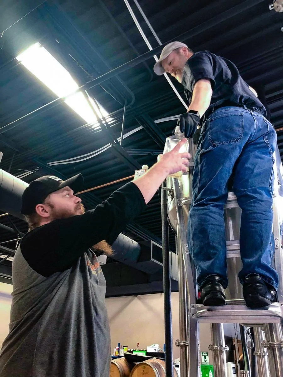 Brewer Reno Wilson and Head Brewer Jim Stinson at BURLY Brewing Company, a craft brewery in Castle Rock, Colorado