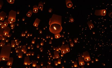 Sky Lanterns float up into the night during Yi Peng