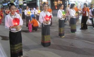 Women in traditional Lanna dress holding Krathong, or lanterns, in parade