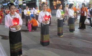 Women in traditional Lanna dress holding Krathong, or lanterns, in parade