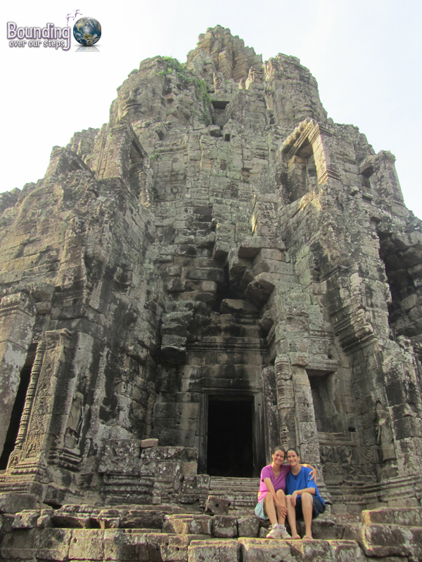 Ligeia and Mindy sitting on the steps of Bayon Temple in Angkor Wat, Cambodia