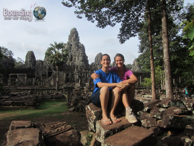 Mindy and Ligeia sitting in front of the ruins of Bayon Temple at Angkor Wat, Cambodia