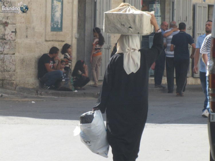 Palestinian woman walking in Bethlehem