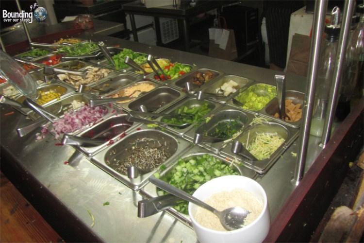 Wide variety of toppings at the salad bar at Buddha Burgers Vegan Restaurant in Tel Aviv