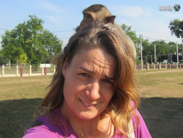 Ligeia with a monkey on her back in Lopburi, Thailand