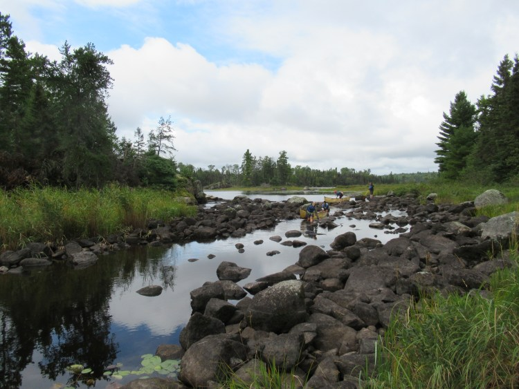 Maneuvering through rocky Horse River in the Boundary Waters Canoe Area (BWCA)