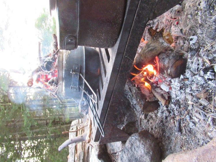 A Dutch oven cooking corn bread in the Boundary Waters Canoe Area (BWCA)