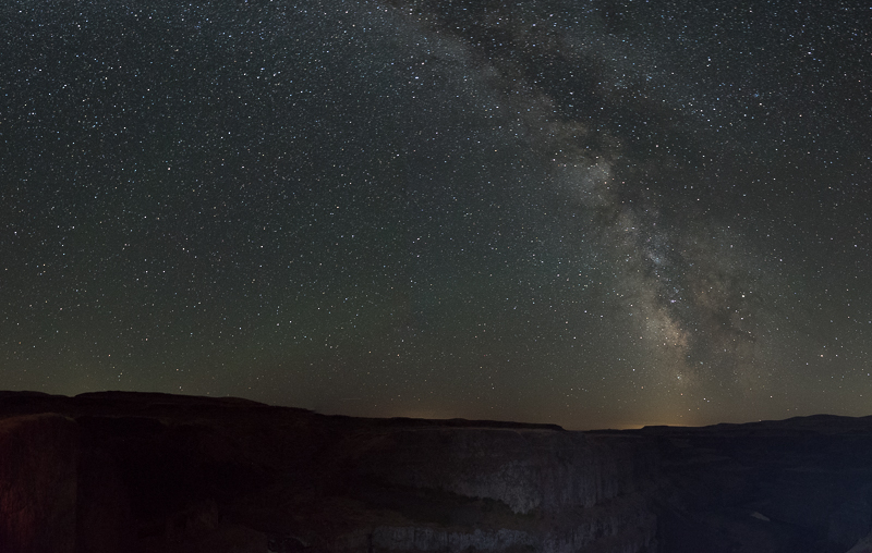 Panorama of the Milky Way over Palouse Falls in Washington. Boundless Journey.