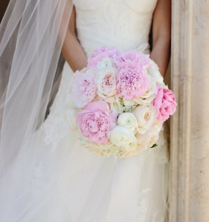 Traditional bouquet of pink peony, ranunucla, and garden roses.