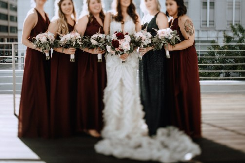 Fall bouquets for bride and bridesmaids in blush and burgandy.