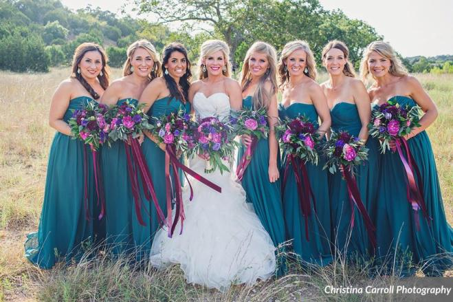 Teal bridesmaids with rich, vibrant bouquets.