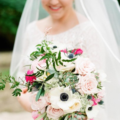 Bridal bouquet of anemones, blush roses and hot pink ranununucal.