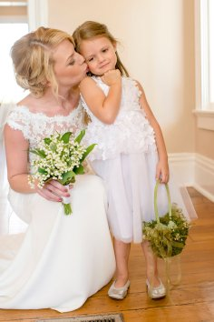 Bride with lily of the valley and flower girl with moss covered basket.