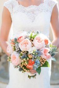 Peach and blue bridal bouquet.