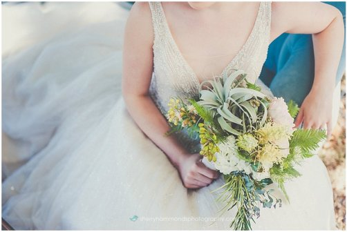 Modern bridal bouquet with tillandsia and blush garden roses.