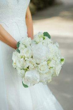 Combination of white flowers including peony, ranunucla and hydrangea.