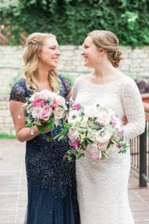 Shades of pink bridesmaids bouquets to complement softer tones of brides bouquet.