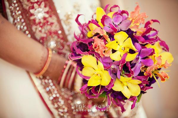 Gold, orange and purple mokara with gloriosa lilies
