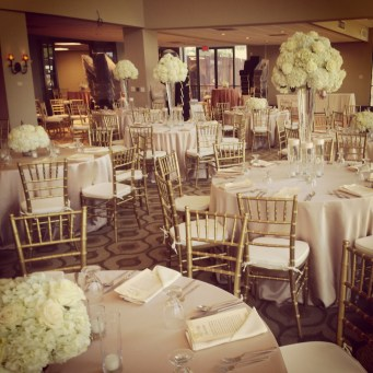Elegant all white floral accented with soft gold and champagne accents.