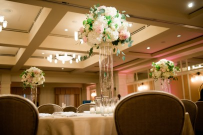 Elevated centerpiece for a traditional ballroom setting.