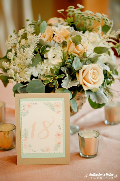 Lush centerpieces filled with dusty miller, silver dollar eucalyptus and neutral blooms.