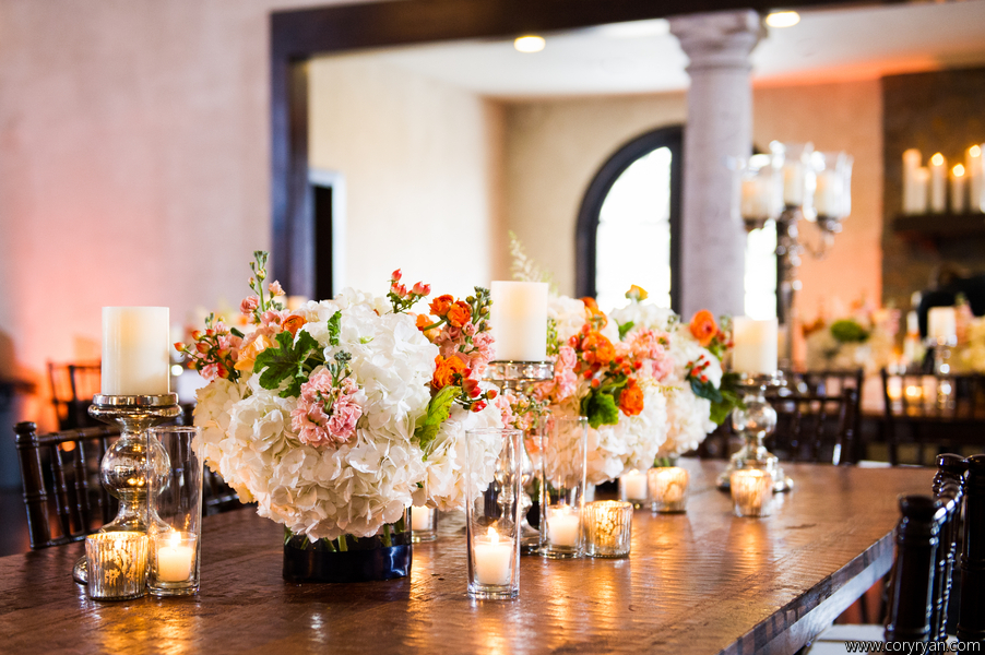 Low lush centerpieces accented with mercury glass.