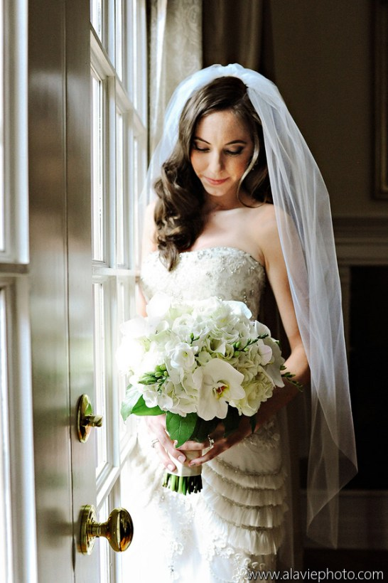 White bridal bouquet featuring white phaelanopsis orchids.