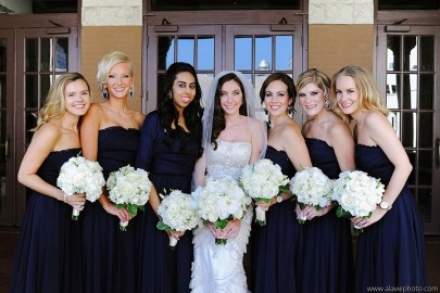 Navy blue bridesmaids gown with all white summer flowers.