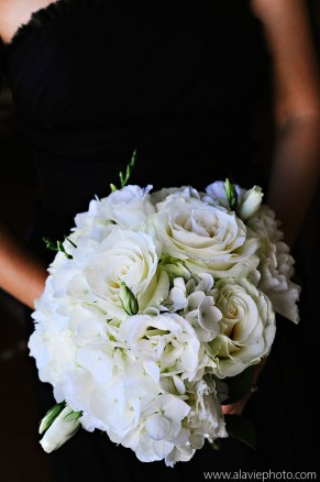 Bridesmaid bouquet of all white flowers- hydrangea, roses, lisianthus and freesia.