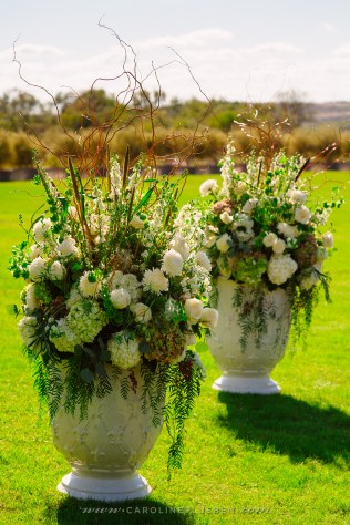 Aisle entry arrangements for outdoor ceremony