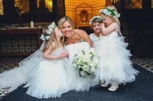 Flower girls with flower crowns and the bride.