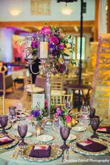 Silver candelabra with jewel toned flowers