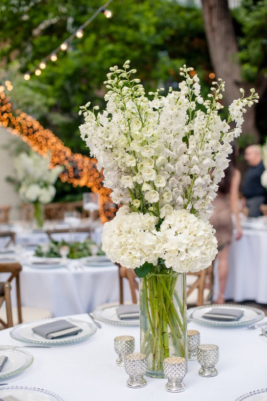 All white centerpiece of delphinium and hydrangea.