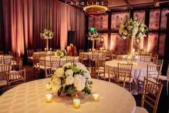 Wedding reception at Hotel Van Zandt featuring golds, greens and whites.