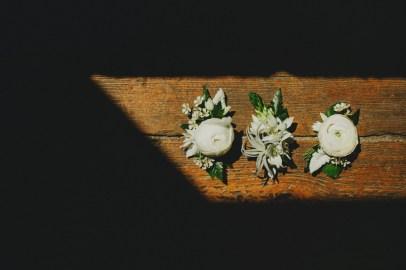 White ranunucla and tillandsia boutonnieres